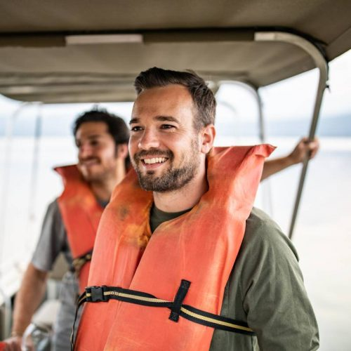 Charlie Clark wearing a life vest on a boat